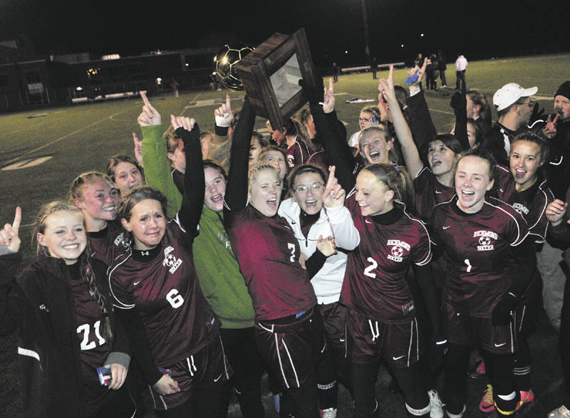WE DID IT: Richmond players hold up the gold ball after beating Washburn 2-1 on penalty kicks to win the Class D state championship Saturday night in Hampden.
