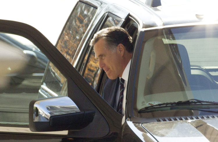 Former Republican presidential candidate Mitt Romney arrives at the White House in Washington on Wednesday for his luncheon with President Barack Obama.
