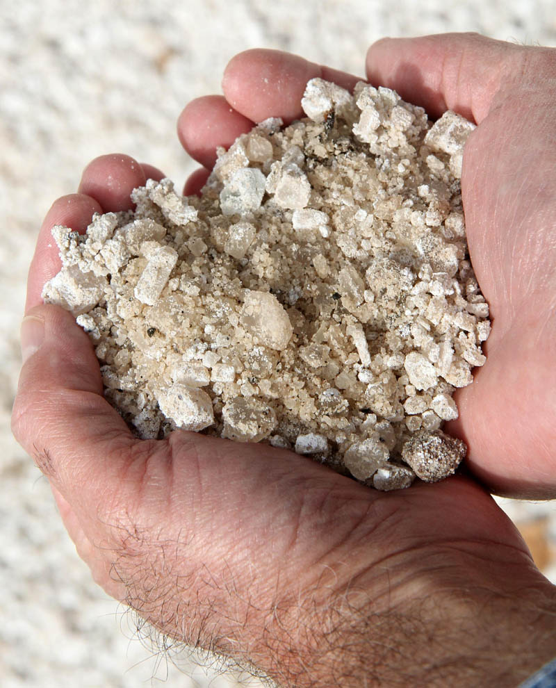 Waterville Public Works Director Mark Turner on Friday holds a handful of salt used on city roads.