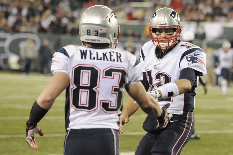 KEEP IT GOING: Wes Welker, left, Tom Brady and the New England Patriots will win their fourth straight AFC East title if they beat the Miami Dolphins on Sunday. New England has won nine division titles in the last 10 seasons.