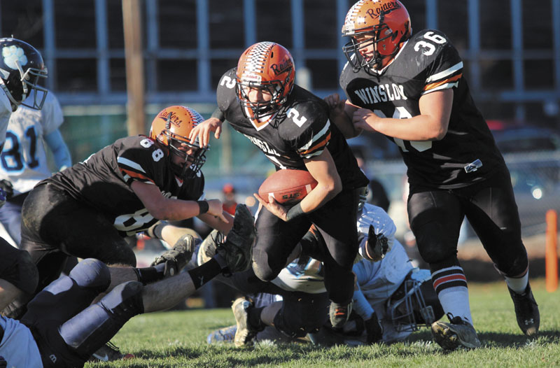 Photo Jeff Pouland LOOKING FOR RUNNING ROOM: Winslow High School's Joseph Hopkins looks upfield for extra yardage after eluding several Dirigo High School defenders during the first half of the Black Raiders' 17-6 victory over the Cougars in the Western Maine Class C final on Saturday.