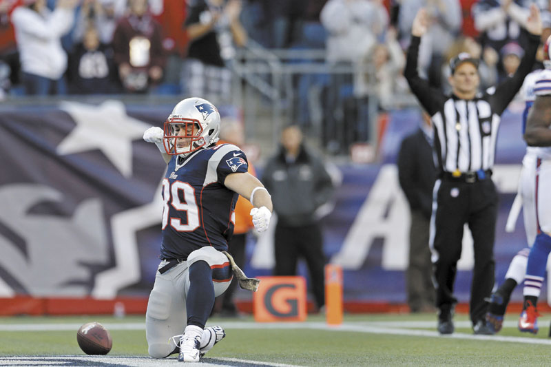 BOOM: New England Patriots running back Danny Woodhead celebrates his touchdown in the third quarter of the Patriots' 37-31 win over the Buffalo Bills on Sunday at Gillette Stadium in Foxborough, Mass. NFLACTION12; Gillette Stadium