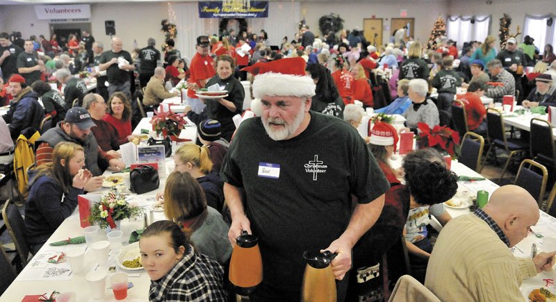 DINERS CLUB: Rick Fischer, a volunteer from South China, looks for empty coffee cups that need filling at the fifth annual Central Maine Family Christmas Dinner at the Elks Lodge in Waterville in 2011.
