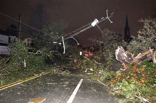 Dauphin Street at North Carlen Street in the Midtown section of Mobile, Ala. is impassable after a tornado touched down Tuesday, Dec. 25, 2012. A Christmas Day twister outbreak left damage across the Deep South while holiday travelers in the nation's much colder midsection battled sometimes treacherous driving conditions from freezing rain and blizzard conditions. (AP Photo/AL.com, Mike Kittrell) MAGS OUT Storm Damage;Tornado;Midtown Mobile