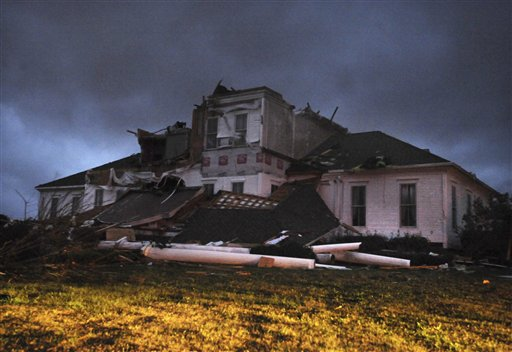 Lightning flashes as another line of thunderstorms approaches a severely damaged home near McNeill, Miss. on Tuesday, Dec. 25, 2012. A Christmas Day twister outbreak left damage across the Deep South while holiday travelers in the nation's much colder midsection battled sometimes treacherous driving conditions from freezing rain and blizzard conditions. (AP Photo/Hattiesburg American, Ryan Moore)