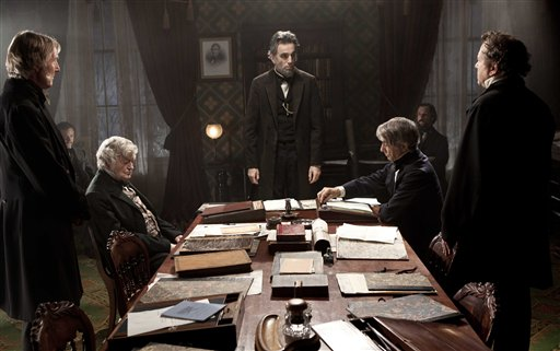 "FILE - This undated publicity photo released by DreamWorks and Twentieth Century Fox shows, Daniel Day-Lewis, center rear, as Abraham Lincoln, in a scene from the film, ""Lincoln."" The film was nominated for a Golden Globe for best drama on Thursday, Dec. 13, 2012. Daniel Day Lewis was also nominated for best actor. The 70th annual Golden Globe Awards will be held on Jan. 13. (AP Photo/DreamWorks, Twentieth Century Fox, David James, File) Daniel Day-Lewis;David Strathairn;Hal Holbrook;Joseph Cross;Jeremy Strong;David Costabile;Byron Jennings"