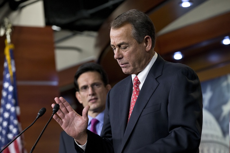 """Speaker of the House John Boehner, R-Ohio, joined by House Majority Leader Eric Cantor, R-Va., left, speaks to reporters about the fiscal cliff negotiations at the Capitol in Washington, Friday, Dec. 21, 2012. Hopes for avoiding the """"fiscal cliff"""" that threatens the U.S. economy fell Friday after fighting among congressional Republicans cast doubt on whether any deal reached with President Barack Obama could win approval ahead of automatic tax increases and deep spending cuts kick in Jan. 1. (AP Photo/J. Scott Applewhite)"""