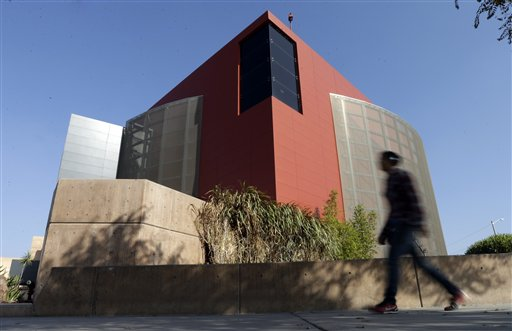 "A man walks past an expansion of the Tijuana Cultural Center known as ""The Cube,"" designed by architect Eugenio Velazquez, in Tijuana, Mexico, recently."