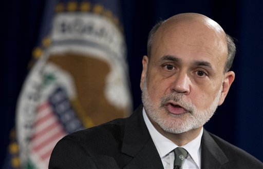 Federal Reserve Chairman Ben Bernanke speaks during a news conference in Washington on Wednesday. The Federal Reserve sent its clearest signal to date Wednesday that it will keep interest rates super-low to boost the U.S. economy even after the job market has improved significantly.