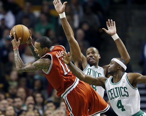 Boston Celtics' Jason Collins, center, fouls Milwaukee Bucks' Monta Ellis (11) as the Celtics' Jason Terry (4) defends in the second quarter of an NBA basketball game in Boston, Friday, Dec. 21, 2012. (AP Photo/Michael Dwyer)