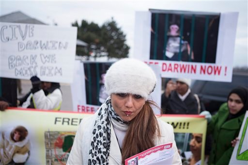 "Yasmin Nakhuda stands with supporters outside an Animal Services offices in Toronto on Wednesday to rally support for the return of her monkey, ""Darwin."""