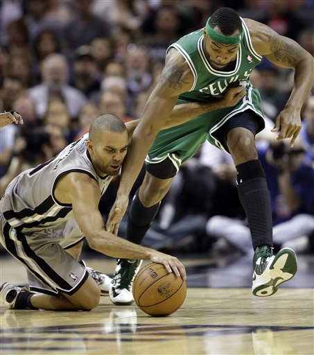 San Antonio Spurs' Tony Parker, left, of France, and Boston Celtics' Chris Wilcox, right, scramble for the loose ball during the fourth quarter of an NBA basketball game, Saturday, Dec. 15, 2012, in San Antonio. San Antonio won 103-88. (AP Photo/Eric Gay)