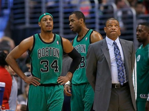 Boston Celtics' Doc Rivers, right, looks toward the screen next to Paul Pierce in the first half of an NBA basketball game against the Los Angeles Clippers in Los Angeles, Thursday, Dec. 27, 2012. (AP Photo/Jae C. Hong)