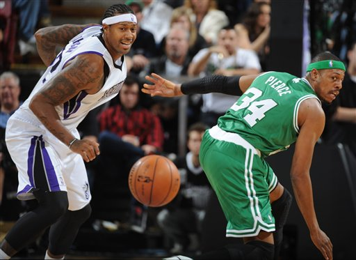 James Johnson of the Sacramento Kings looks to steal the ball against Paul Pierce of the Boston Celtics during an NBA basketball game on Sunday, Dec. 30, 2012 at Sleep Train Arena in Sacramento, Calif. (AP Photo/ The Sacramento Bee, Hector Amezcua)MANDATORY CREDIT HJA_7558.jpg
