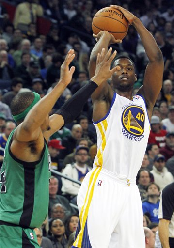 Golden State Warriors' Harrison Barnes (40) shoots as Boston Celtics' Paul Pierce guards during the second half of an NBA basketball game in Oakland, Calif., Saturday, Dec. 29, 2012. (AP Photo/George Nikitin) ORACLE Arena