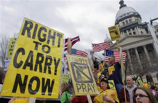 In this March 7, 2012, photo, gun owners and supporters participate in an Illinois Gun Owners Lobby Day rally at the Illinois State Capitol in Springfield.