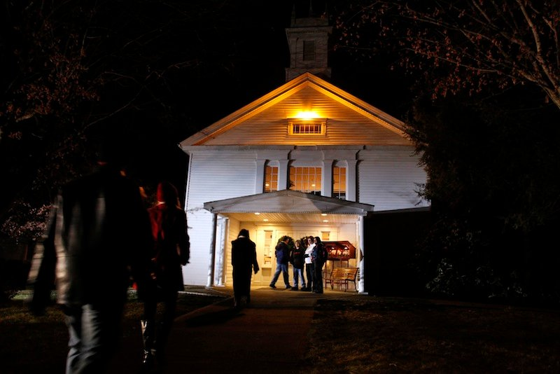 People arrive for a prayer service at Newtown United Methodist Church in the aftermath of a mass shooting at nearby Sandy Hook Elementary School, Friday, Dec. 14, 2012 in Newtown, Conn. A gunman walked into the school Friday and opened fire, killing 26 people, including 20 children. (AP Photo/Jason DeCrow)