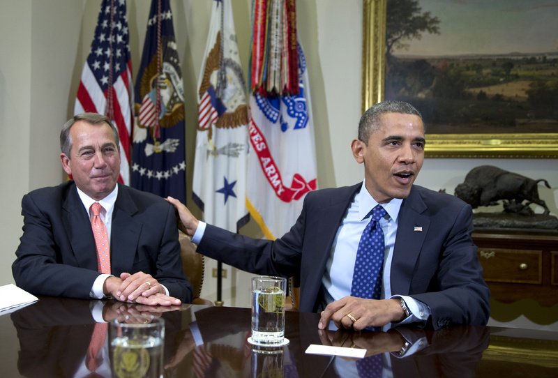 """President Obama acknowledges House Speaker John Boehner of Ohio while speaking to reporters in the Roosevelt Room of the White House in Washington on Nov. 16. Administration officials say Obama and Boehner met Sunday at the White House to discuss the ongoing negotiations over the impeding """"fiscal cliff."""""""