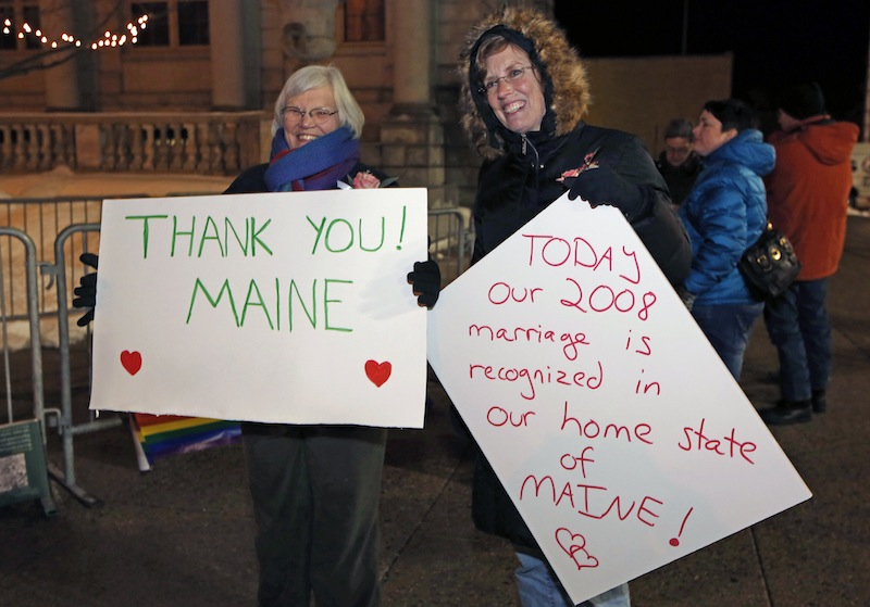 Lucie Bauer, left, and Annie Kiermaier, of Rockport, Maine, celebrate the imminent recognition of their marriage in their home state, Friday, Dec. 28, 2012, in Portland, Maine. The couple was married in California in 2008. Same-sex couples in Maine will be allowed to marry as a new law goes into effect at 12:01 a.m. Saturday, Dec. 29. (AP Photo/Robert F. Bukaty)