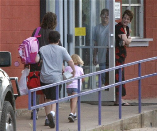 Students arrive for the first day of classes at the Harrold Independent School District in Harrold, Texas, in this 2008 file photo. The school has a policy allowing teachers and other employees to carry concealed weapons on campus. Some lawmakers in at least five other states are looking into similar legislation. Anti-gun groups oppose the measure.