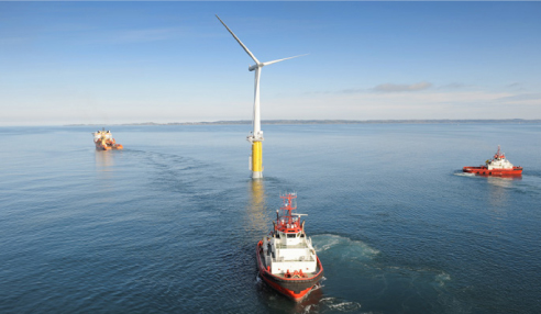 In this June 2009 publicity photo, tugboats haul the demonstration Hywind floating wind turbine out to sea off of the coast of Norway for testing. The company is proposing to erect similar turbines in the deep waters of the Gulf of Maine.