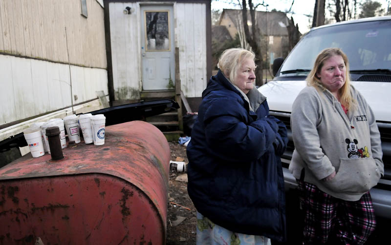 Judith Farris, left, and her daughter, Becky Ratcliff, may be moving from their China home, if the town carries out an order to raze the trailer and outbuilding.