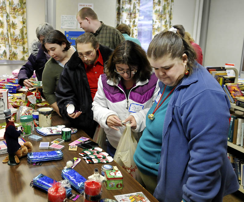 People line up for gifts Tuesday during a Christmas celebration at the Prince of Peace Lutheran Church in Augusta. Volunteers donated cooked meals and presents for guests.