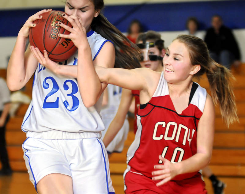 HANG ON: Erskine Academy's Bridget Humphrey, left, holds a rebound under pressure from Cony High School's Olivia Deeves during the Rams' 60-40 win Thursday in South China.
