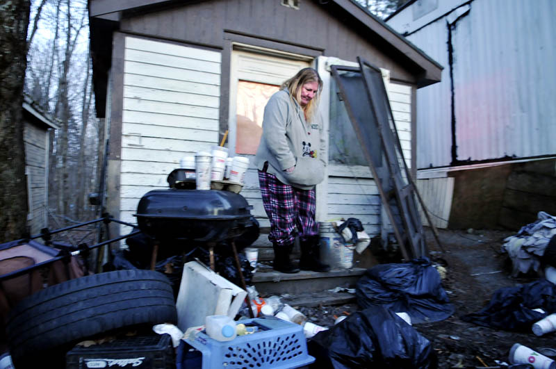 "Becky Ratcliff stays in an outbuilding she describes as a ""bedroom"" on the China property of her mother, Judith Farris, in China. The town may raze the property, forcing the couple to relocate."