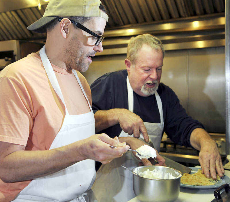 Mike Giberson, right, and Neil Andersen prepare latkes Sunday in the kitchen of the A1 Diner in Gardiner. The restaurant's owners served a special menu to celebrate the arrival of Hanukkah, including the potato pancakes.