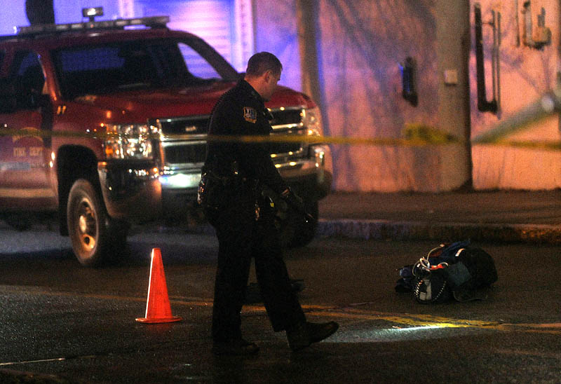 Police investigate the scene where a man was shot on The Concourse late Tuesday night in Waterville.