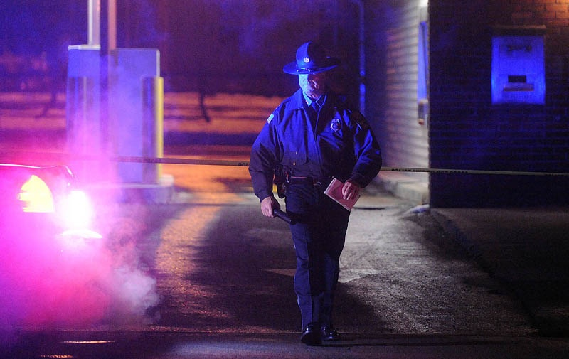 Michael Emmons, Skowhegan police chief, emerges from the drive-through teller bay at Franklin Savings Bank on Madison Avenue in Skowhegan on Thursday, while investigating a robbery.