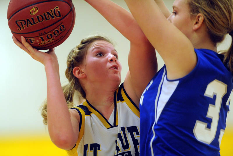 Staff photo by Michael G. Seamans Mt. Blue High School's Jaycee Jenckes, left, tries to get a shoot over Lawrence High School defender Nia Irving in the first quarter Friday at Mt. Blue High School in Farmington.