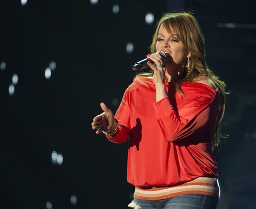 Latin singer Jenni Rivera rehearses for the 2012 Billboard Latin Music Awards in this April 25, 2012, photo.