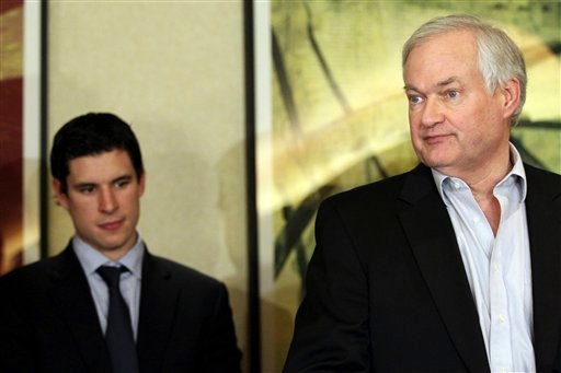 Pittsburgh Penguins' Sidney Crosby, left, listens as Don Fehr, executive director for the National Hockey League Players Association, speaks to reporters on Thursday, Dec. 6, 2012, in New York. Fehr said that he believed an agreement was close, only to change his position moments later when the NHL rejected the union's most recent offer.