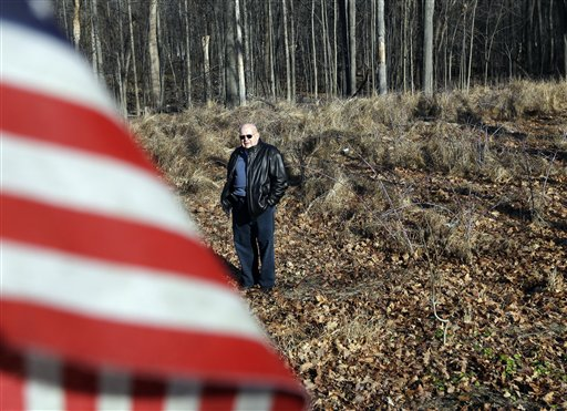 Lee Carlson, of Gardiner, N.Y., poses Thursday in a field of unmarked graves from the Revolutionary War in Fishkill, N.Y. Research conducted by a local historical organization has managed to put names to 25 soldiers out of the hundreds of soldiers believed to have been buried here during the American Revolution. Carlson's family tree includes Archelaus Towne, a 45-year-old captain from New Hampshire who fought at Bunker Hill and Saratoga before dying of dysentery and fever at Fishkill on Dec. 1, 1779.
