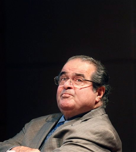 U.S. Supreme Court Justice Antonin Scalia found himself on Monday defending his legal writings that some find offensive and anti-gay. Scalia has been giving speeches around the country to promote his new book,