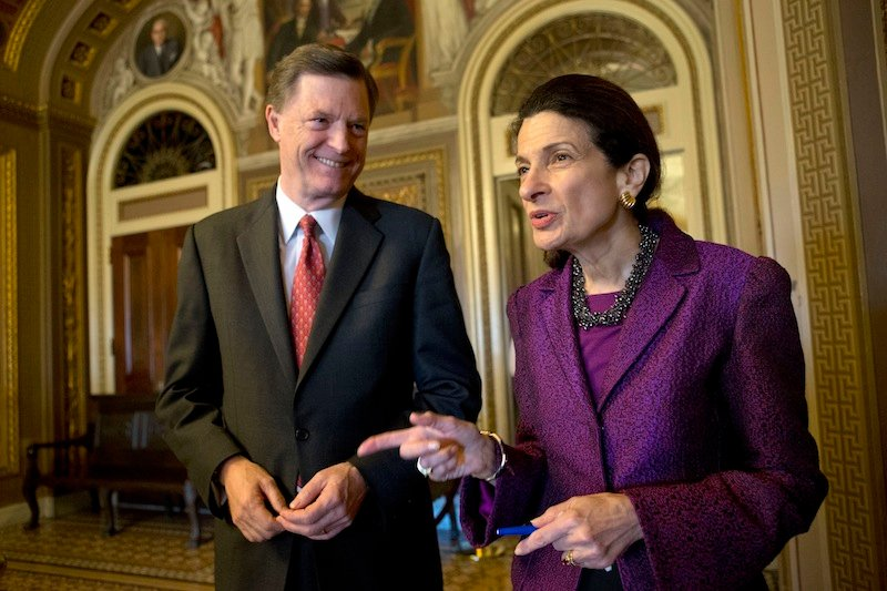 """Retiring Sen. Olympia Snowe, R-Maine, accompanied by her husband, former Maine Gov. John """"Jock"""" McKernan Jr., talks on Capitol Hill in Washington on Thursday after giving her farewell speech in the Senate chamber. Snowe said she remains hopeful that the Senate can overcome """"excessive political polarization"""" to work together to reach consensus on important issues facing the nation."""