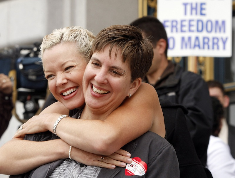In this file photo from Aug. 12, 2010, gay couple Tara Walsh, left, and Wen Minkoff embrace outside City Hall in San Francisco. The U.S. Supreme Court decided Friday, Dec. 7, 2012, to hear the appeal of a ruling that struck down Proposition 8, the state's measure that banned same sex marriages. The highly anticipated decision by the court gives the justices the chance to say by late June whether gay Americans have the same constitutional right to marry as heterosexuals. (AP Photo/Ben Margot)