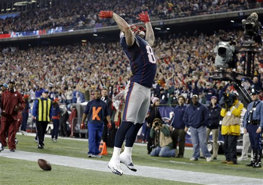 New England Patriots tight end Aaron Hernandez celebrates his touchdown catch against the Houston Texans during the second quarter of the NFL football game in Foxborough, Mass., Monday. Gillette Stadium