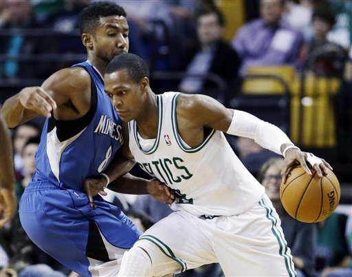 Boston Celtics point guard Rajon Rondo (9) drives against Minnesota Timberwolves guard Malcolm Lee, left, during the second half of an NBA basketball game in Boston, Wednesday. The Celtics won 104-94. TD Garden