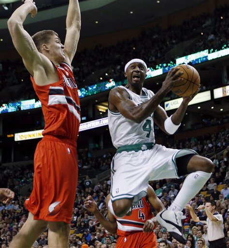 Boston Celtics' Jason Terry (4) looks to shot against Portland Trail Blazers' Meyers Leonard during the first quarter of an NBA basketball game in Boston, Friday, Nov. 30, 2012. (AP Photo/Michael Dwyer)