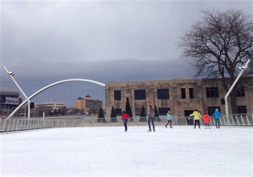 Skaters make their way across ice at Brenton Skating Plaza in downtown Des Moines on Thursday. Iowa's capital city is expecting clear skies Friday.