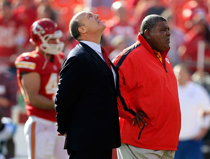 Kansas City Chiefs GM Scott Pioli, left, and Coach Romeo Crennel stand together before Sunday's game against the Carolina Panthers at Arrowhead Stadium in Kansas City, Mo. NFLACTION12;