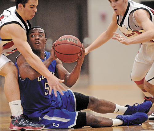 HELP ME: Colby College's Shane Rogers, center, tries to pass the ball as Thomas College defenders Adam Carlsen, left,, and Ray Bernier try to make a steal Tuesday at Thomas College in Waterville Tuesday. Thomas defeated Colby 88-83.
