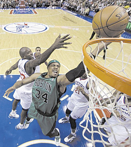 TO THE HOLE: Boston's Paul Pierce, center, goes up for a layup against Philadelphia's Jason Richardson, left, in the first half Friday in Philadelphia.