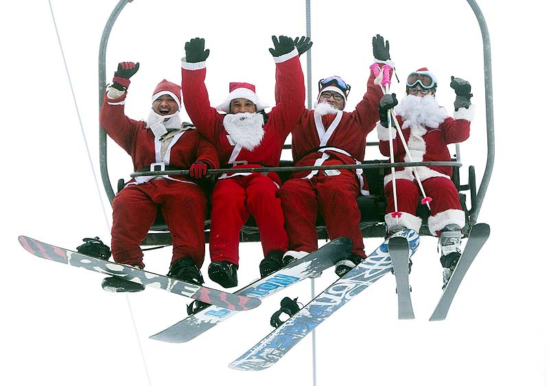 A group of Santas ride a chairlift on Sunday at the Sunday River Ski Resort in Newry, Maine. More than 250 skiers and snowboarders participated in the annual Santa Sunday event to raise money to benefit the Bethel Rotary Club's Christmas for Children program.