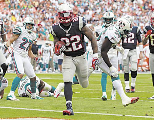 STEPPING UP: New England Patriots running back Stevan Ridley (22) is third in the AFC with 1,010 yards going into tonight's game against the Houston Texans. The emergence of Ridley has helped balance out the Patriots offense this season.