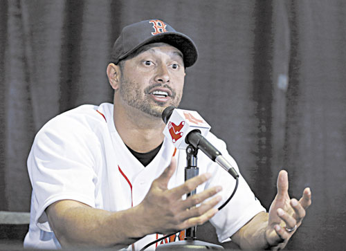 SIGNED, SEALED, DELIVERED: New Boston Red Sox outfielder Shane Victorino speaks during an introductory news conference Thursday at Fenway Park in Boston. The Red Sox signed Victorino to a $39M, three-year deal.