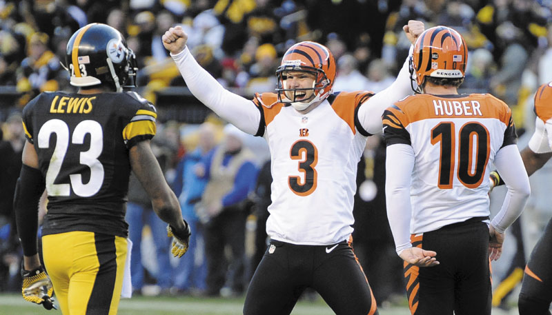WE'RE IN: Cincinnati's Josh Brown (3) celebrates hitting a 43-yard field goal with 4 seconds left in the Bengals' 13-10 win over the Pittsburgh Steelers on Sunday in Pittsburgh. NFLACTION12;